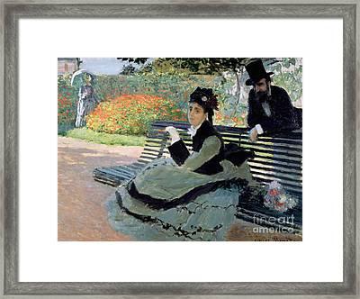 Madame Monet On A Garden Bench Framed Print by Claude Monet