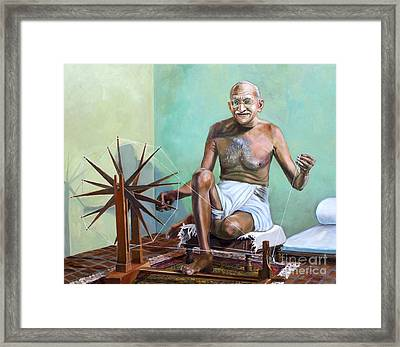 Mahatma Gandhi Spinning Framed Print by Dominique Amendola