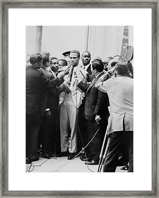 Malcolm X Being Interviewed Framed Print by Everett