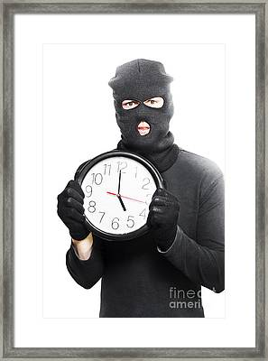 Male Criminal In Mask Holding A Clock Framed Print by Jorgo Photography - Wall Art Gallery