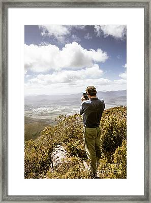 Male Tourist Taking Photo On Mountain Top Framed Print by Jorgo Photography - Wall Art Gallery