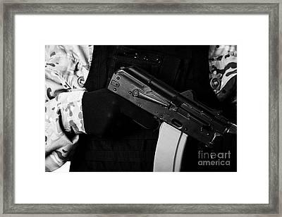 Man In Combat Fatigues And Bullet Proof Jacket Holding Aks-47u Close Quarter Combat Kalashnikov Rifl Framed Print by Joe Fox
