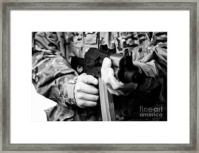 Man In Combat Fatigues Holding Aks-47u Close Quarter Combat Kalasknikov Rifle Focus On Safety Select Framed Print by Joe Fox