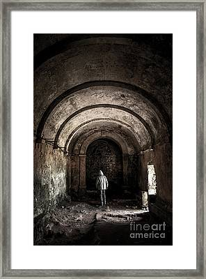 Man Inside A Ruined Chapel Framed Print by Carlos Caetano