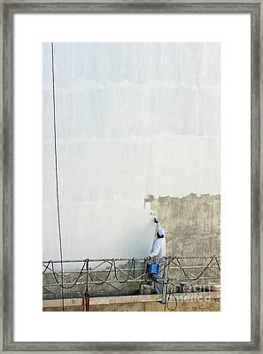 Man Painting The Facade Of A Building Framed Print by Sami Sarkis