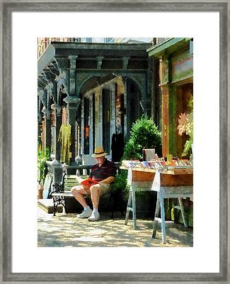 Man Reading By Book Stall Framed Print by Susan Savad