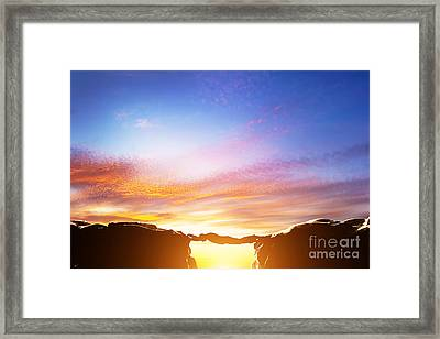 Man Serving As A Bridge Over Precipice Between Two Mountains Framed Print by Michal Bednarek