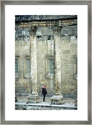 Man Walking Between Columns At The Roman Theatre Framed Print by Sami Sarkis