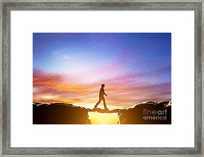Man Walking Over Precipice Between Mountains And Another Man Being A Bridge Framed Print by Michal Bednarek