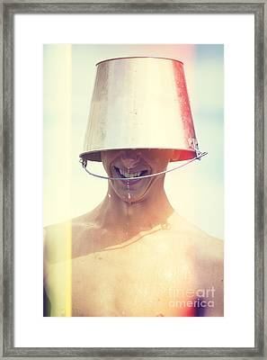 Man Wearing Water Bucket On Head In Summer Heat Framed Print by Jorgo Photography - Wall Art Gallery
