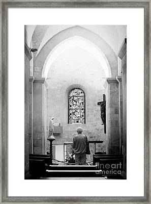 Man Worshipping At Saint Pierre De Montmartre Framed Print by Ivy Ho