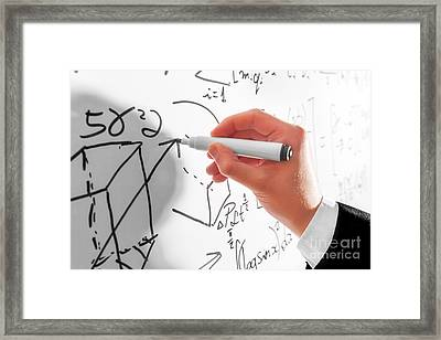 Man Writing Complex Math Formulas On Whiteboard. Mathematics And Science Framed Print by Michal Bednarek