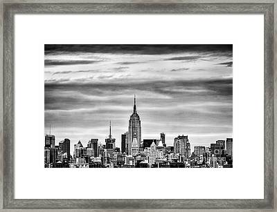 Manhattan Skyline Framed Print by John Farnan