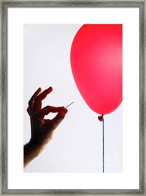 Man's Hand With Pin Next To Balloon Framed Print by Sami Sarkis