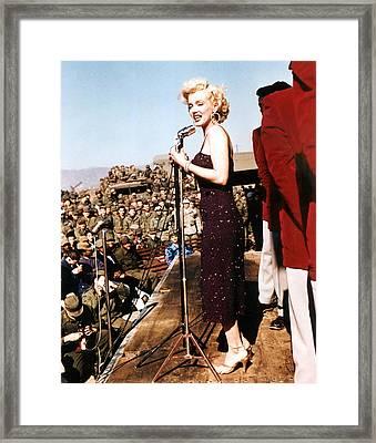 Marilyn Monroe Entertaining The Troops Framed Print by Everett