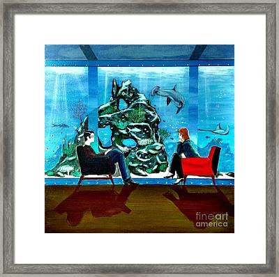 Marinlife Observing Couple Sitting In Chairs Framed Print by John Lyes
