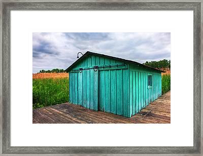 Marshland Boathouse Framed Print by James Marvin Phelps