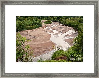 Meandering Sky Framed Print by Fred Lassmann