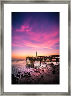 Meeting On The Pier Framed Print by Marvin Spates