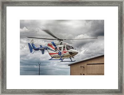 Mercy Flight 8 Framed Print by Guy Whiteley