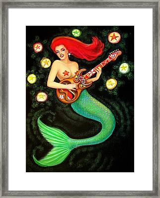 Mermaids Rock Tiki Guitar Framed Print by Sue Halstenberg