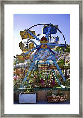 Merry Wheel Framed Print by Madeline Ellis