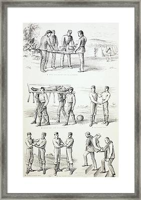 Methods Of Carrying Injured Persons Framed Print by Vintage Design Pics