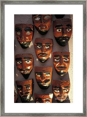 Mexican Devil Masks Framed Print by John  Mitchell