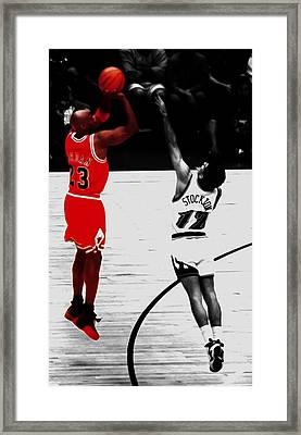 Michael Jordan Over John Stockton Framed Print by Brian Reaves