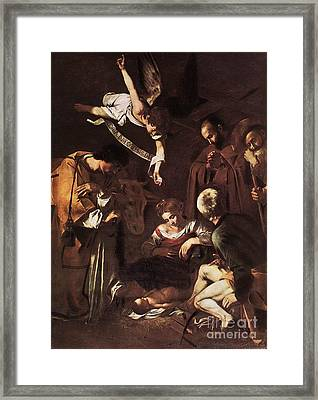 Nativity With St Francis And St Lawrence Framed Print by Michelangelo Merisi da Caravaggio