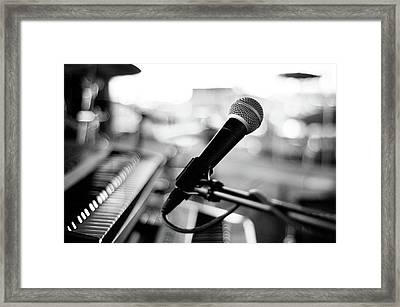 Microphone On Empty Stage Framed Print by Image By Randymsantaana