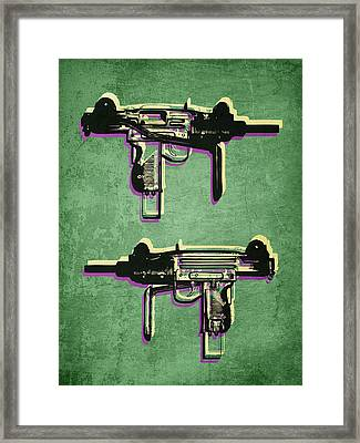 Mini Uzi Sub Machine Gun On Green Framed Print by Michael Tompsett
