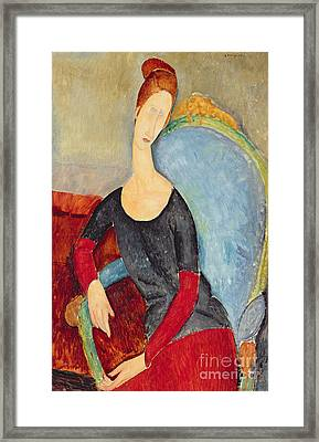 Mme Hebuterne In A Blue Chair Framed Print by Amedeo Modigliani