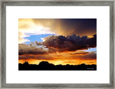 Monsoon Sunset Framed Print by David Coyle