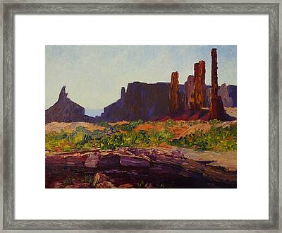 Monument Valley Totem Poles Framed Print by Terry  Chacon