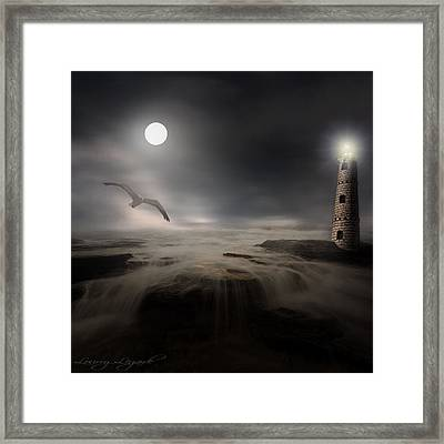 Moonlight Lighthouse Framed Print by Lourry Legarde