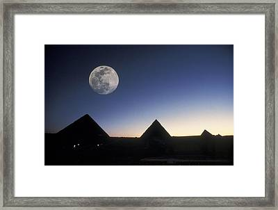 Moonrise Above Giza Pyramids In Egypt Framed Print by Richard Nowitz