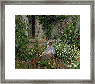 Mother And Child In The Flowers Framed Print by Camille Pissarro