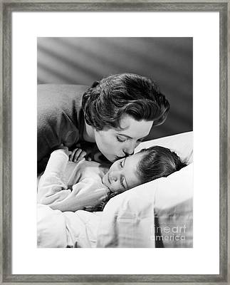 Mother Kissing Girl Goodnight, C.1950s Framed Print by H. Armstrong Roberts/ClassicStock