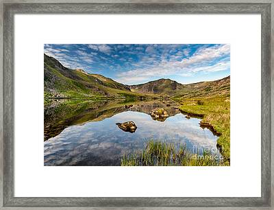 Mountain Reflection Framed Print by Adrian Evans