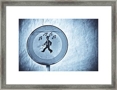 Musicman Walking Framed Print by Keith Sanders