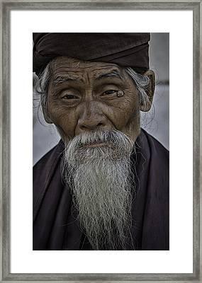 Myanmar Holy Man Framed Print by David Longstreath