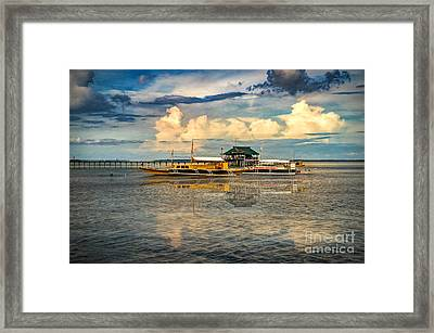 Nalusuan Boats Framed Print by Adrian Evans