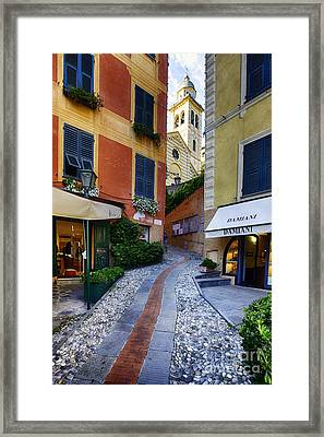 Narrow Street Leading Up To A Church In Portofino Framed Print by George Oze