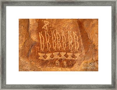 Native American Petroglyph On Orange Sandstone Framed Print by John Stephens