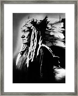 Native American Sioux Chief Sitting Framed Print by Everett