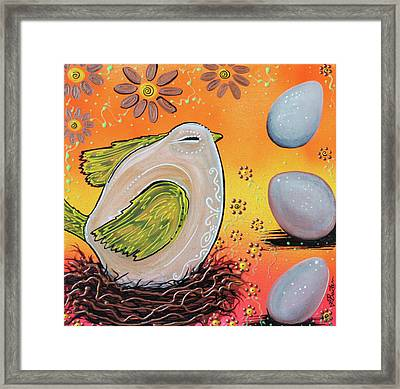 Nesting Bird Framed Print by Laura Barbosa