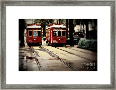 New Orleans Red Streetcars Framed Print by Perry Webster