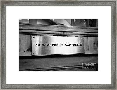 no hawkers or campbells sign in the clachaig inn site of the massacre of glencoe Scotland UK  Framed Print by Joe Fox