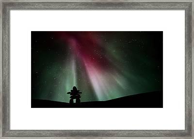Northern Lights Above An Inukchuk In Saskatchewan Framed Print by Mark Duffy
